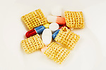 Drugs and breakfast ceral represent our dependence of prescription and OTC drugs.