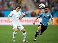 Leighton Baines of England and Alvaro Gonzalez of Uruguay