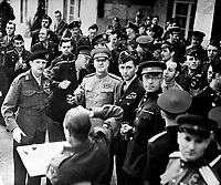 Marshall Zhukov decorates Field Marshall Montgomery with the Russian Order of Victory.  Allied chiefs who attended the cermony at Gen. Eisenhower's Headquarters at Frankfurt are about to drink a toast.  June 10, 1945.  British Official.  (OWI)<br /> NARA FILE #:  208-AA-342BB-1<br /> WAR & CONFLICT BOOK #:  1097