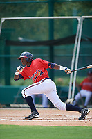 GCL Braves first baseman Jean Carlos Encarnacion (25) follows through on a swing during a game against the GCL Pirates on July 27, 2017 at ESPN Wide World of Sports Complex in Kissimmee, Florida.  GCL Braves defeated the GCL Pirates 8-6.  (Mike Janes/Four Seam Images)