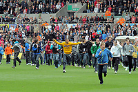 Pictured: Delighted Swansea City fans storm to the ground after their team's 4-0 win. Saturday 07 May 2011<br /> Re: Swansea City FC v Sheffield United, npower Championship at the Liberty Stadium, Swansea, south Wales.
