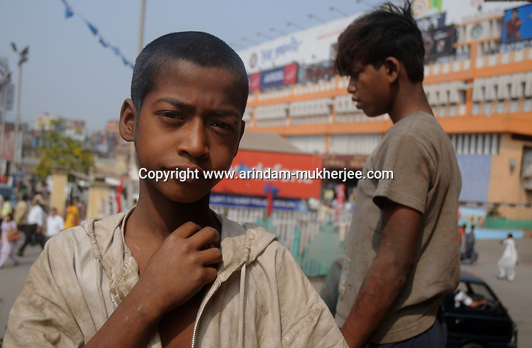 Alamgir and his mate at the Sealdah railway premises. Alamgir is staying here for last 6 years from the time he ran away from his home due to domestic violence and poverty. As per his version his father was a drunkard and used to beat his mother for no reason. His father even could not earn enough money to buy food for their big family. Due to this traumatic situation he ran away from house at the age of seven. Ever since, the Sealdah railway station in Kolkata has been his home. As far as company is concerned, he had not much reason to miss his family. There are around 500 children, from 5 to 16 years, who live in the premises of Kolkata's second largest train terminus. Most of them addicted to Brown Sugar and sniffing industrial adhesive Dendrite. They say they don't feel hungry if they take the drugs. Their presence is conspicuous, even in a place that registers an average footfall of 1.4 million on weekdays. Their activities cover a wide range, from begging, to pulling handcarts, to petty theft, to selling odds and ends on the platform or on trains. The money, earned or ill-gotten as the case may be, is spent in procuring heroin, brown sugar, cocaine, and tubes of Dendrite. Calcutta, West Bengal, India. Arindam Mukherjee