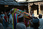 The Dussehra Festival is held in October or early November each year. At this time  Raghunathji (Lord Rama), the presiding Deity of the Kullu Valley, is brought from the Raghunath Temple to Dhalpur Maidan in Kullu. There are around 360 village devtas (gods) and they are carried down from each village to Kullu to pay homage to Lord Raghunathji and to attend the assembly of the gods.The festival celebrates the victory of good over evil, when Lord Rama defeated Ravana the demon king of Lanka. The local residents are carrying the murti of Vashisht who was one of the Saptarishis and spiritual master (guru) of Lord Rama..Vashisht, Himachal Pradesh, India.
