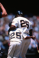 SAN FRANCISCO, CA:  Barry Bonds of the San Francisco Giants hugs his son Nikolai Bonds at home plate during a game against the Arizona Diamondbacks at Pacific Bell Park in San Francisco, California in 2000. (Photo by Brad Mangin)