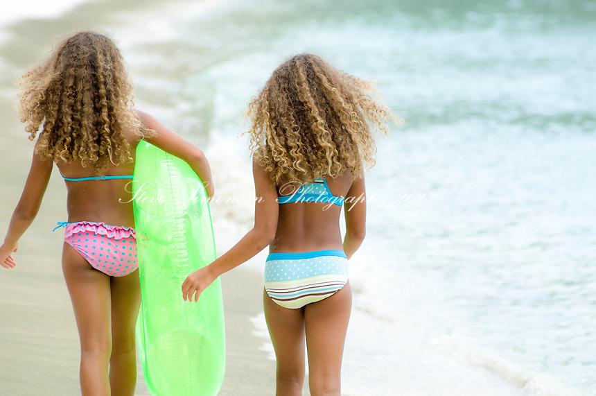 Twins enjoying a day at the beach<br /> Gibney Beach<br /> St. John<br /> US Virgin Islands