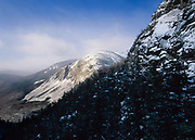 Cannon Cliffs on the side of Cannon Mountain in Franconia Notch State Park in the New Hampshire White Mountains covered in snow from Eagle Pass. Eagle Pass is along the Greenleaf Trail.