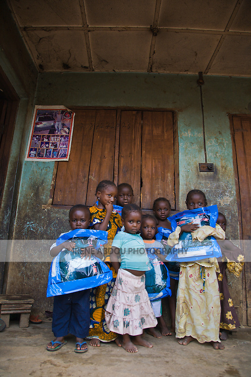 A group of children in the Garki area of Abuja, Nigeria hold Permanet long lasting insecticide treated mosquito nets (LLIN).  The nets are distributed by Nigeria's largest indigenous NGO, the Society for Family Health, and partner of the international NGO, Population Services International.  Sleeping under an LLIN every night prevents malaria, a life-threatening disease transmitted through the bite of infected mosquitoes.
