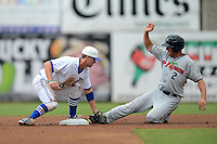 Dunedin Blue Jays second baseman Jon Berti (5) tags out Mike Kvasnicka (2) sliding in during a game against the Fort Myers Miracle on July 20, 2013 at Florida Auto Exchange Stadium in Dunedin, Florida.  Fort Myers defeated Dunedin 3-1.  (Mike Janes/Four Seam Images)