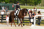 LEXINGTON, KY - APRIL 29: #90 Arthur and rider Allison Springer make their way into the warm up ring before their Dressage test in the Rolex Three Day Event, Dressage Day 1, at the Kentucky Horse Park in Lexington, KY, where they finished 2nd overall in Dressage.  April 29, 2016 in Lexington, Kentucky. (Photo by Candice Chavez/Eclipse Sportswire/Getty Images)