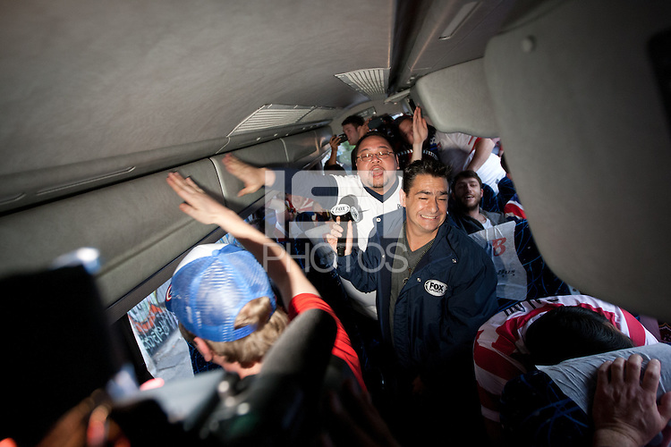 A reporter from Fox Sports reports on a bus full of USA fans chanting songs while arriving for the USA vs. Mexico World Cup Qualifier at Azteca stadium in Mexico City, Mexico on March 26, 2013.
