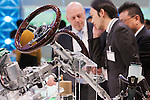 December 30, 2011, Tokyo, Japan - Businessmen talk in front a display of car parts during the 42nd Tokyo Motor Show. The show opens to the general public from December 3-11. (Photo by Christopher Jue/AFLO)