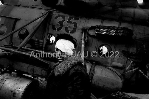 Grozny, Chechyna.January 1995.A Russian soldier, wounded while fighting in Grozny, waits to be taken by helicoper to the main military hospital in Mozdok, about 140 KM to the north.