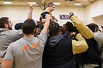 February 10, 2018- Tuscola, IL- Illini Football players surround and hoist Tuscola's Colton Rahn in celebration after Rahn made a basket during his biddy basketball game. The Illini Football team surprised Rahn, a big Illini fan who has cerebral palsy, as they came to watch him play basketball. [Photo: Douglas Cottle]