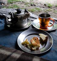 Kashmiri tea and bread at tent door, Kanka River, near Naranag, Kashmir, India.