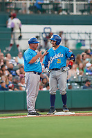 Amarillo Sod Poodles manager Phillip Wellman (30) talks with Luis Torrens (21) during a Texas League game against the Frisco RoughRiders on July 13, 2019 at Dr Pepper Ballpark in Frisco, Texas.  (Mike Augustin/Four Seam Images)