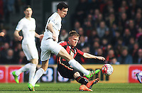 Jack Cork of Swansea City and Matt Ritchie of Bournemouth during the Barclays Premier League match between AFC Bournemouth and Swansea City played at The Vitality Stadium, Bournemouth on March 11th 2016