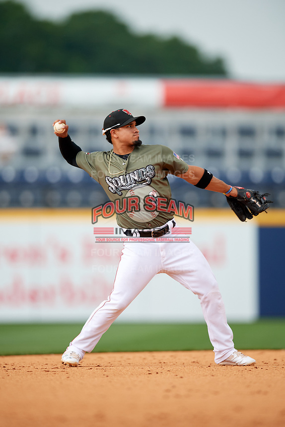 Nashville Sounds shortstop Franklin Barreto (9) throws to first base during a game against the New Orleans Baby Cakes on April 30, 2017 at First Tennessee Park in Nashville, Tennessee.  The game was postponed due to inclement weather in the fourth inning.  (Mike Janes/Four Seam Images)