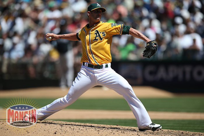 OAKLAND, CA - JUNE 13:  Grant Balfour #50 of the Oakland Athletics pitches against the New York Yankees during the game at O.co Coliseum on Thursday June 13, 2013 in Oakland, California. Photo by Brad Mangin