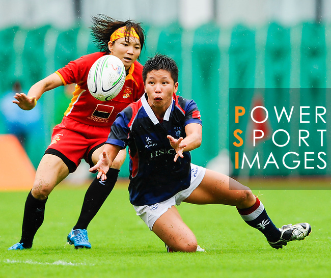Hong Kong women play China during Day 1 of the HSBC Asian 7s at the Yuanshen stadium on August 27, 2011 in Shanghai, China. Photo by © Photo by © Victor Fraile / The Power of Sport Images for Fast Track / HSBC