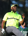 Former MLB player Kenny Lofton uses some body English on a shot in the final round of the American Century Championship at Edgewood Tahoe Golf Course in Stateline, Nev., on Sunday, July 19, 2015. <br /> Photo by Cathleen Allison