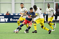 FOXBOROUGH, MA - MAY 16: Gustavo Bou #7 of New England Revolution passes the ball under pressure from Artur #8 Columbus SC and Jonathan Mensah #4 Columbus SC during a game between Columbus SC and New England Revolution at Gillette Stadium on May 16, 2021 in Foxborough, Massachusetts.