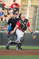 Kannapolis Intimidators catcher Zach Fish (28) tracks a pop fly behind home plate during the game against the Hickory Crawdads at CMC-Northeast Stadium on May 21, 2015 in Kannapolis, North Carolina.  The Intimidators defeated the Crawdads 2-0 in game two of a double-header.  (Brian Westerholt/Four Seam Images)