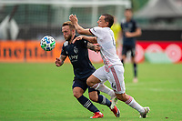 LAKE BUENA VISTA, FL - JULY 22: Johhny Russell #7 of Sporting Kansas City and Donny Toia #4 of Real Salt Lake battle for the ball during a game between Real Salt Lake and Sporting Kansas City at Wide World of Sports on July 22, 2020 in Lake Buena Vista, Florida.