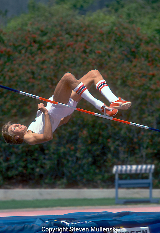 """High Jumper Dwight Stones clears the bar during the 1978 AAU Track and Field Championships at Drake Stadium at UCLA..Dwight Edwin Stones (born December 6, 1953 in Los Angeles, California) is an American television commentator and a two-time Olympic bronze medalist and former three-time world record holder in the men's high jump. During his 16-year career, he won 19 national championships. In 1984, Stones became the first athlete to both compete and announce at the same Olympics. Since then, he has been a color analyst for all three major networks in the United States and continues to cover track and field on television...Stones set his first world record when he cleared 2.30 m (7 ft 6+1?2 in) in 1973 at Munich, Germany. That jump also made him the first """"flop"""" jumper to set a world high jump record, five years after Dick Fosbury made that jumping style famous while winning the Mexico City Olympics. Stones raised the world record to 2.31 m (7 ft 7 in) in 1976 and added another centimeter to the record two months later...Stones was one of the world's top high jumpers from 1972 to 1984 and has been twice named the World Indoor Athlete of the Year by Track & Field News. At age 18, he represented the U.S. for the first time at the 1972 Olympic Games, placing third in the high jump competition. Four years later, he was again third. He returned to the Olympics in 1984, finishing fourth after setting his 13th American record at that year's Trials...Stones attended California State University, Long Beach and is a member of that University's Hall of Fame...In 1988, Stones was inducted into the USA Track and Field Hall of Fame."""