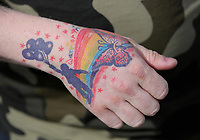 "COPY BY TOM BEDFORD<br /> Pictured: A rainbow tattoo on the arm of Josh Chambers, the father of Mia Chambers<br /> Re: One of Britain's poorest towns is raising £100,000 to send a little girl to America because the lifesaving drugs she needs are not available on the NHS.<br /> Brave Mia Chambers, five, is in remission after having an ovary and kidney removed due to neuroblastoma, a rare and aggressive type of cancer.<br /> Doctors have told her parents Josh and Kirsty there is a 50 per cent chance of the cancer returning without the specialist drugs.<br /> Josh, 28, said: ""That's not a chance we are prepared to take - the odds are too high.<br /> ""We researched it on the internet and found children in the US are beating this terrible illness.<br /> ""Doctors there are willing to treat her but it will cost more money than we have.""<br /> The couple's plight has touched the hearts of people in their home town of Merthyr Tydfil, South Wales, and money has begun pouring in.         <br /> Mia had chemotherapy on the Rainbow ward at the Noah's Ark Children's Hospital for Wales where nurses nicknamed her the Rainbow Warrior because of her fighting spirit."