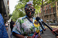 Milan,Italy - 19th june 2021 - Dolce & Gabbana fashion show for Milano fashion week Men's collection 18-22 june 2021 - colorful look woman with white sunglasses