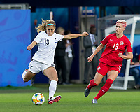 GRENOBLE, FRANCE - JUNE 15: Rosie White #13 of the New Zealand National Team passes the ball as Sophie Schmidt #13 of the Canadian National Team defends during a game between New Zealand and Canada at Stade des Alpes on June 15, 2019 in Grenoble, France.
