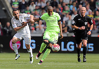 Fernandinho of Manchester City (C) is held back by Leon Britton of Swansea City during the Swansea City FC v Manchester City Premier League game at the Liberty Stadium, Swansea, Wales, UK, Sunday 15 May 2016