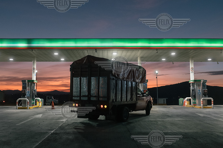 A truck enters a petrol stationoin a highway in Guanajuato State.