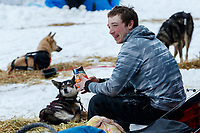 Matt Hall eats a snack while resting at the Eagle Island checkpoint on Saturday March 9th during the 2019 Iditarod Trail Sled Dog Race.<br /> <br /> Photo by Jeff Schultz/  (C) 2019  ALL RIGHTS RESERVED