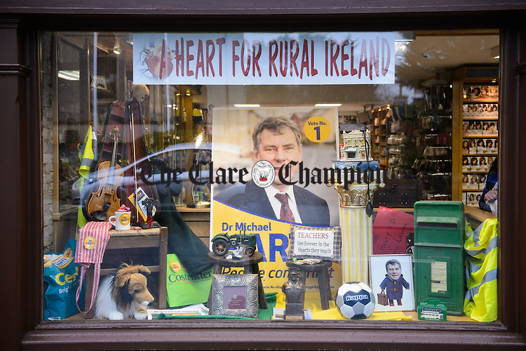 The Chemistry Of Politics....A strong expression of support for the local candidate in the shop window of the local pharmacy in Kilmihil village. Photograph by John Kelly.
