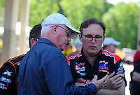 May 6, 2012; Commerce, GA, USA: NHRA top fuel dragster driver Doug Kalitta (right) talks with NHRA Official Graham Light during the Southern Nationals at Atlanta Dragway. Mandatory Credit: Mark J. Rebilas-