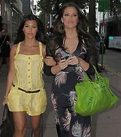 MIAMI BEACH, FL - JUNE 06:  Kourtney (L)  and Khloe Kardashian  take a lunch break in Miami. on June 6, 2009 in Miami Beach, Florida.<br /> <br /> People:  Kourtney Kardashian , Khloe Kardashian