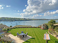 BNPS.co.uk (01202) 558833. <br /> Pic: LillicrapChilcott/BNPS<br /> <br /> Pictured: Gardens leading to the private jetty onto the water.<br /> <br /> An impressive waterfront home with panoramic views over one of Britain's most popular estuaries is on the market for £2.75m.<br /> <br /> Tregytreath is the perfect property for boat lovers, with access to the foreshore and its own private jetty onto the water.<br /> <br /> The five-bedroom house is in Restronguet Point, one of the most exclusive waterside locations in Cornwall, and this property has one of the most outstanding positions among those prestigious homes.<br /> <br /> The house was designed and built, by the current owners 20 years ago, to make the most of the beautiful views.