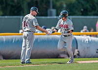 4 September 2017: Tri-City ValleyCats infielder Kyle Davis heads home and gets congratulated by Manager Morgan Ensberg after hitting a solo home run in the 4th inning during the first game of a double-header against the Vermont Lake Monsters at Centennial Field in Burlington, Vermont. The ValleyCats split their games, winning 6-5 in the first, then dropping the second 7-4 to the Lake Monsters in NY Penn League action. Mandatory Credit: Ed Wolfstein Photo *** RAW (NEF) Image File Available ***
