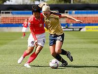 Olivia Klei (USA) and Hyun Young Lee (KOR) compete for the ball..FIFA U17 Women's World Cup, USA v Korea Republic, Waikato Stadium, Hamilton, New Zealand, Sunday 9 November 2008. Photo: Renee McKay/PHOTOSPORT