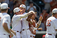 Texas Longhorns pitcher John Curtiss (43) celebrates with teammate Parker French (24) following the NCAA Super Regional baseball game against the Houston Cougars on June 7, 2014 at UFCU Disch–Falk Field in Austin, Texas. The Longhorns are headed to the College World Series after they defeated the Cougars 4-0 in Game 2 of the NCAA Super Regional. (Andrew Woolley/Four Seam Images)