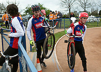 19 APR 2015 - IPSWICH, GBR - Ashley Hill (left) and Matt Hill (right) of Ipswich Eagles walk to the start of a heat during the Elite League cycle speedway fixture against Sheffield Stars at Whitton Sports and Community Centre in Ipswich, Suffolk, Great Britain  (PHOTO COPYRIGHT © 2015 NIGEL FARROW, ALL RIGHTS RESERVED)