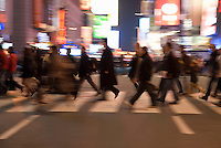 AVAILABLE FROM GETTY IMAGES FOR COMMERCIAL AND EDITORIAL LICENSING.   Please go to www.gettyimages.com and search for image # 135307803.<br /> <br /> Busy, Blurred Motion Scene of Commuters Crossing Street and Heading Home After Work During the Evening Rush Hour, Times Square and 42nd Street, Midtown Manhattan, New York City, New York State, USA