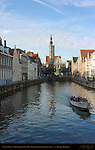 Canal Scene: Tourist Boat on the Spinolarei at Sunrise, Poortersloge Burgher's Lodge in the distance, Bruges, Brugge, Belgium