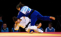 04 DEC 2011 - LONDON, GBR - Sally Conway (GBR) (in white) tries to throw Laura Vargas Koch (GER) (in blue) during their semi final contest at the London International Judo Invitational and 2012 Olympic Games test event at the ExCel Exhibition Centre in London, Great Britain (PHOTO (C) NIGEL FARROW)