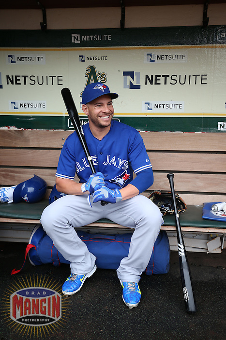 OAKLAND, CA - JULY 23:  Danny Valencia #23 of the Toronto Blue Jays smiles in the dugout before the game against the Oakland Athletics at O.co Coliseum on Thursday, July 23, 2015 in Oakland, California. Photo by Brad Mangin