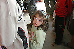 A young girl watches her older brother as he listens to U.S. soldiers chatting with a shopkeeper in Samarra, Iraq. Soldiers with Company C, 2nd Battalion, 327th Infantry Regiment say they encounter hostile fire and IEDs almost daily in the city, but these photos were taken during a rare four-day period when no attacks occurred. Nov. 16, 2007. DREW BROWN/STARS AND STRIPES