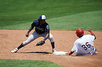 Vermont Lake Monsters shortstop Eric Marinez (2) looks to tag Kelvin Gutierrez (36) stealing second during a game against the Auburn Doubledays on July 13, 2016 at Falcon Park in Auburn, New York.  Auburn defeated Vermont 8-4.  (Mike Janes/Four Seam Images)