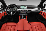Stock photo of straight dashboard view of 2018 BMW X6 sDrive35i 5 Door SUV Dashboard