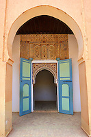 Arabesque plasterwork and doorway of the  Alaouite Ksar Fida built by Moulay Ismaïl the second ruler of the Moroccan Alaouite dynasty ( reigned 1672–1727 ). Residence of the Khalifa or Caid of Tafilalet until 1965. Tafilalet Oasis, near Rissini, Morocco